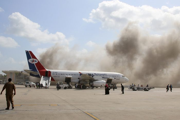 Yemen attack: 'At least 12 killed' in large explosion at Aden airport as government officials land